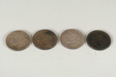 5: LOT OF FOUR MORGAN SILVER DOLLARS