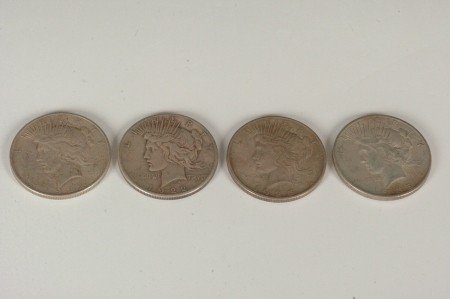 10: LOT OF FOUR PEACE SILVER DOLLARS