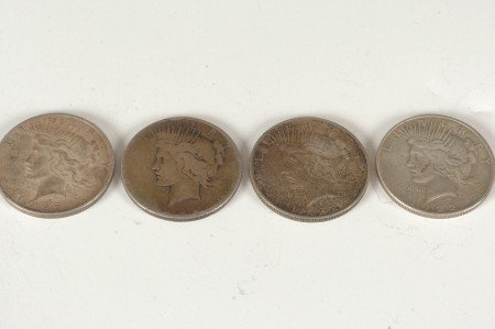11: LOT OF FOUR PEACE SILVER DOLLARS