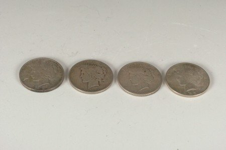 12: LOT OF FOUR PEACE SILVER DOLLARS