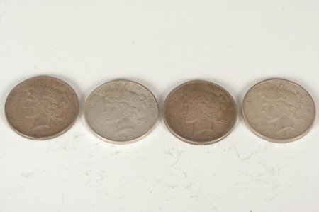 14: LOT OF FOUR PEACE SILVER DOLLARS