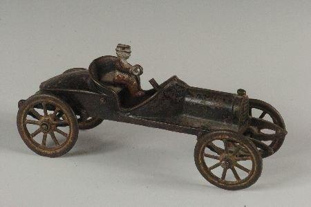 AN A.C. WILLIAMS CAST IRON RACER - AS FOUND