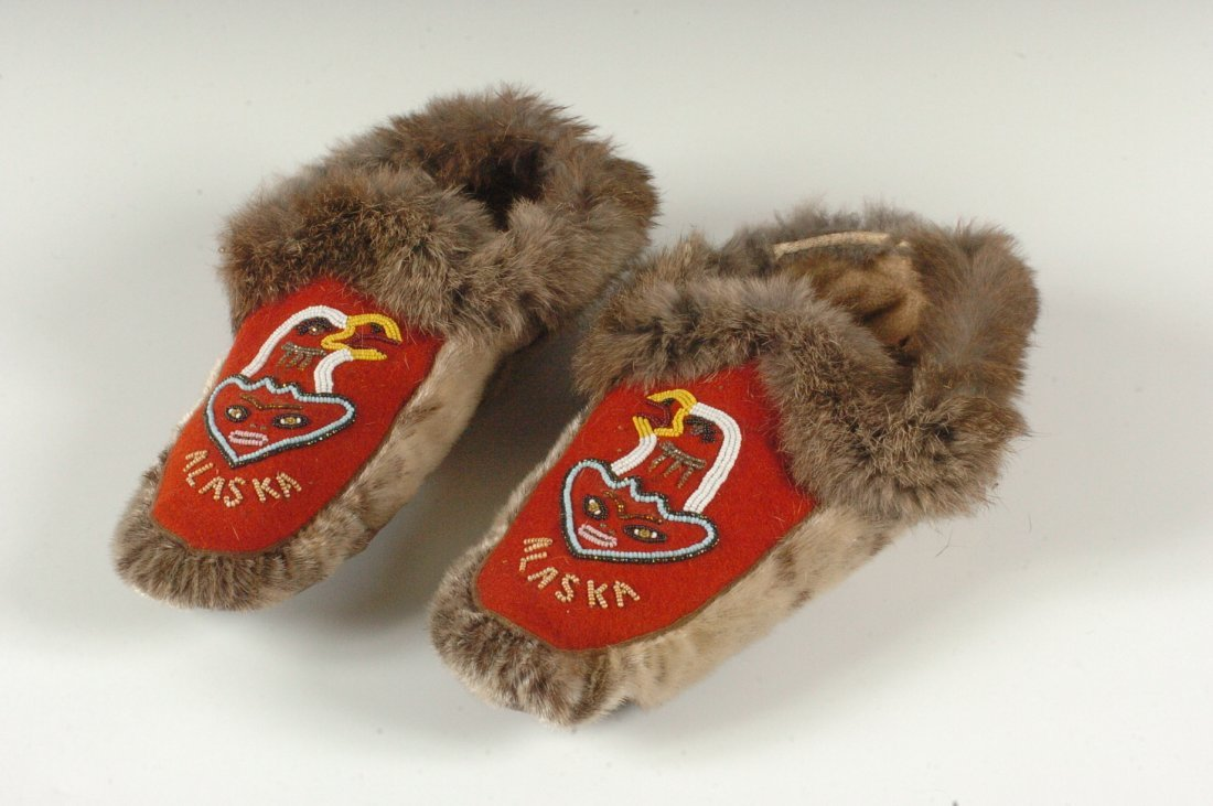 A PAIR OF ALASKAN TLINGLIT PARTIALLY BEADED MOCCASINS