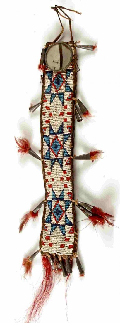 A GOOD SIOUX BEADED HAIR ORNAMENT CIRCA 1885