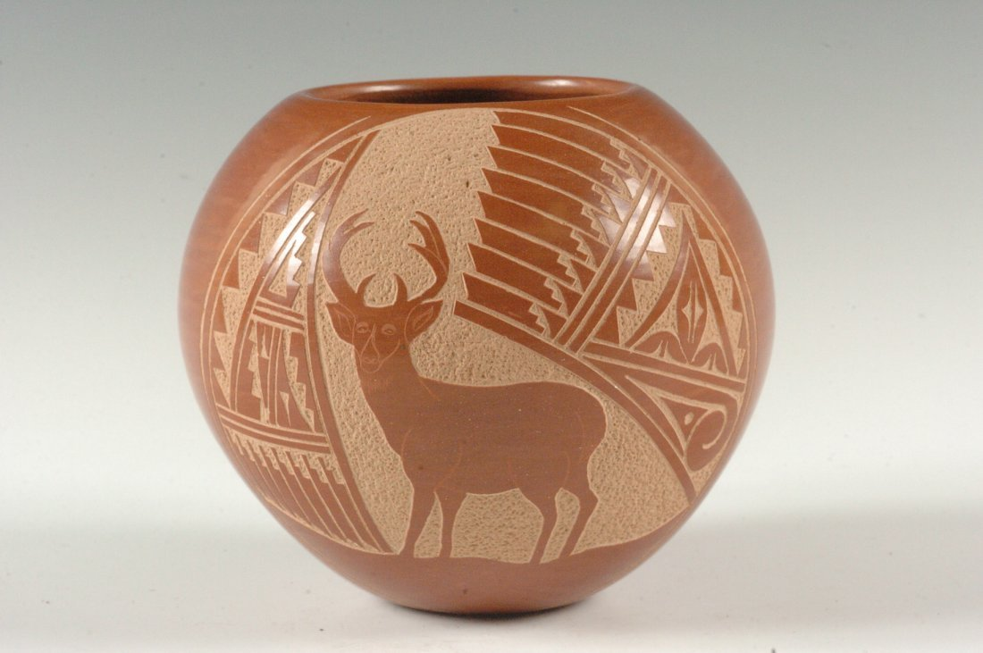 A JEMEZ CARVED POTTERY VASE BY CAROL VIGIL