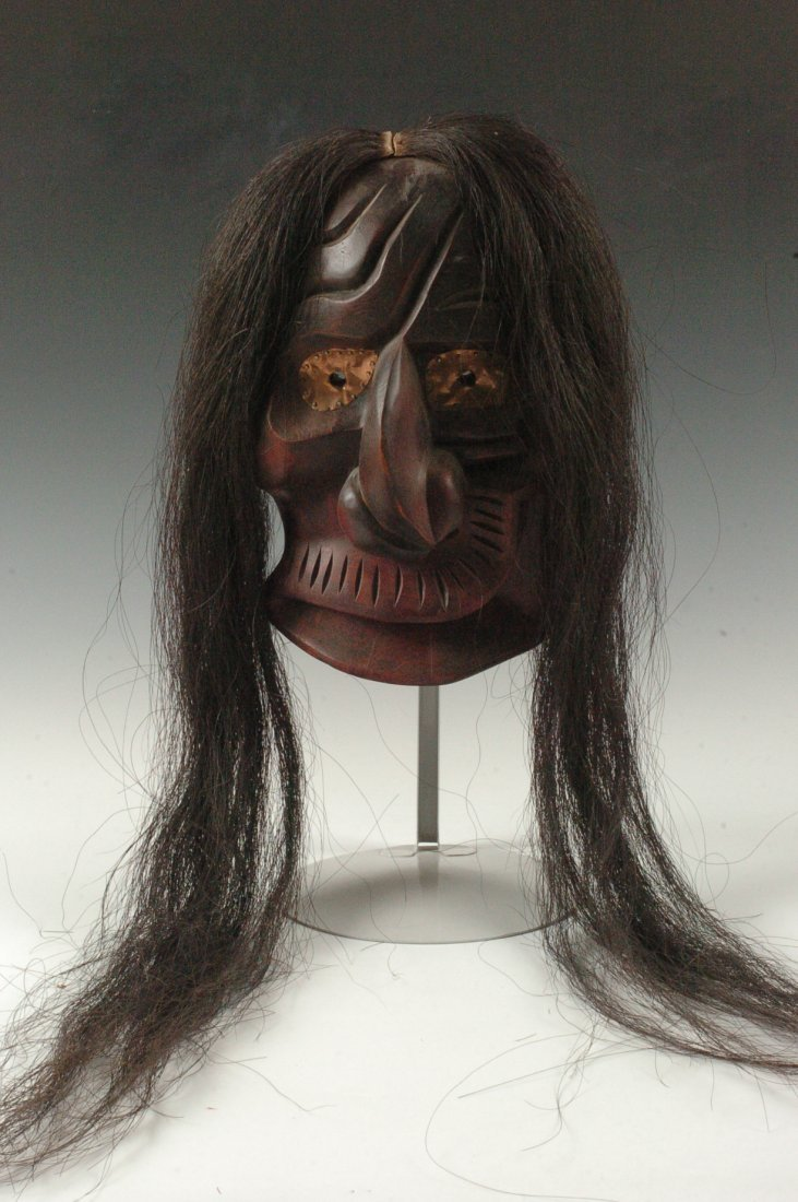 AN IROQUOIS ONONDAGA WOLF CLAN CARVED WOOD MASK