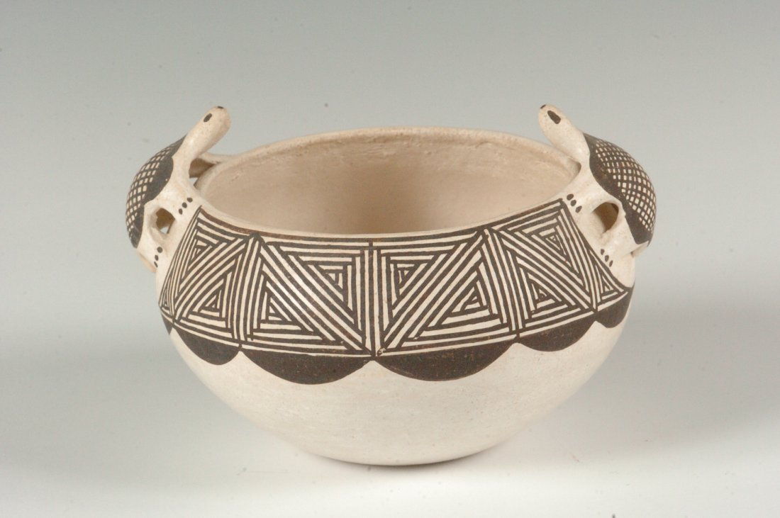 AN ACOMA POTTERY VESSEL WITH TURTLE EFFIGIES SIGNED G.