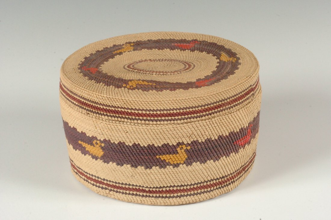 A MAKAH COVERED BASKET WITH WATERFOWL, 1933