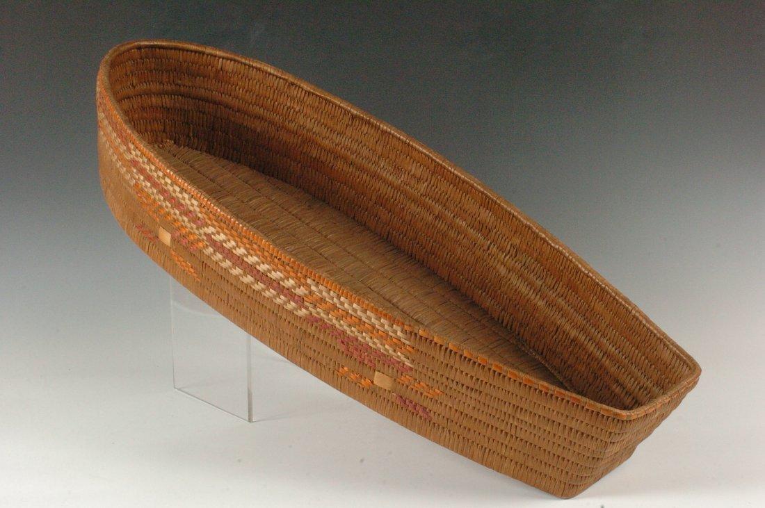 A SALISH BOAT SHAPE BASKETRY TRAY CIRCA 1900