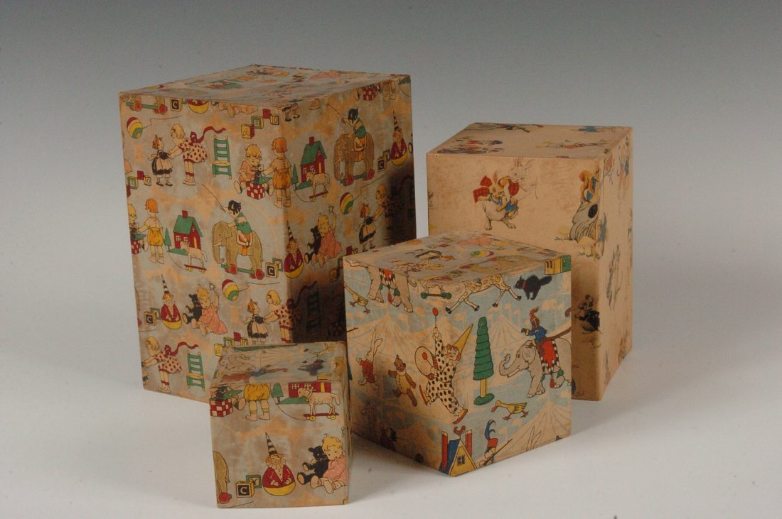 CIRCA 1920s STACKING CARDBOARD BLOCKS WITH RATTLE