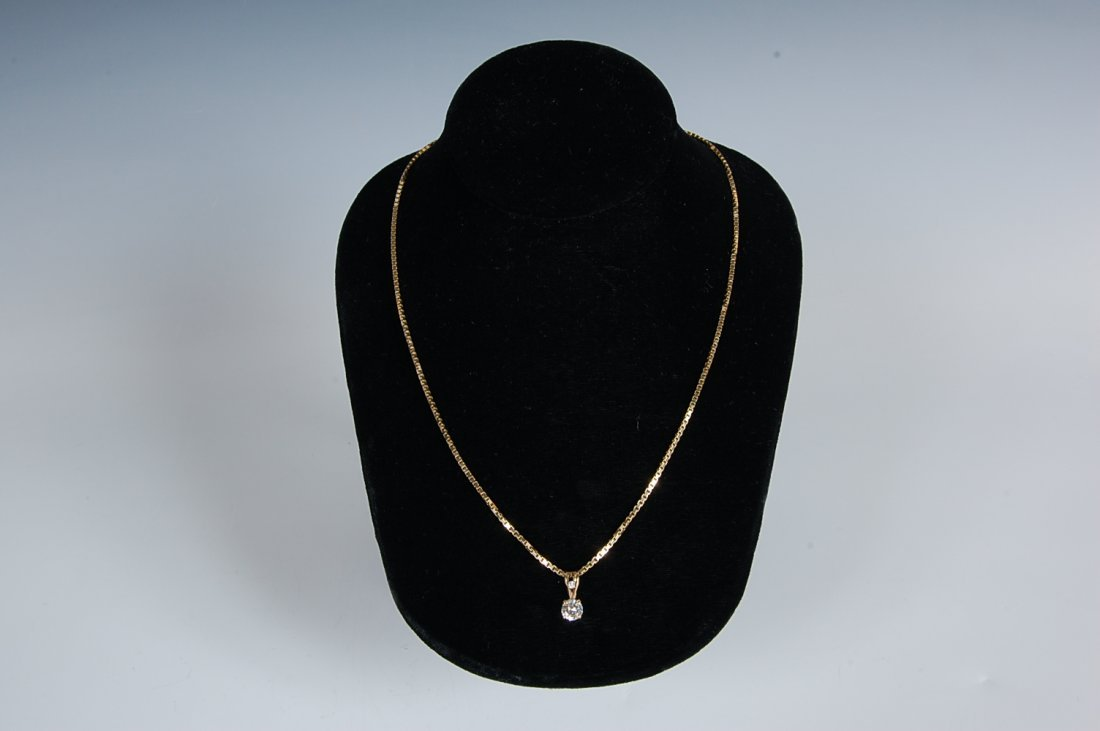 APPROXIMATELY .80 CARAT DIAMOND SOLITARE 14K CHAIN AND