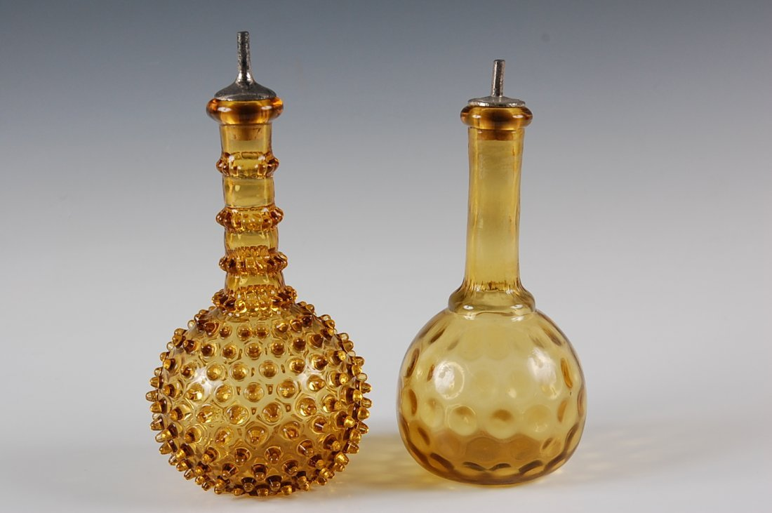 TWO ANTIQUE AMBER GLASS BARBER BOTTLES