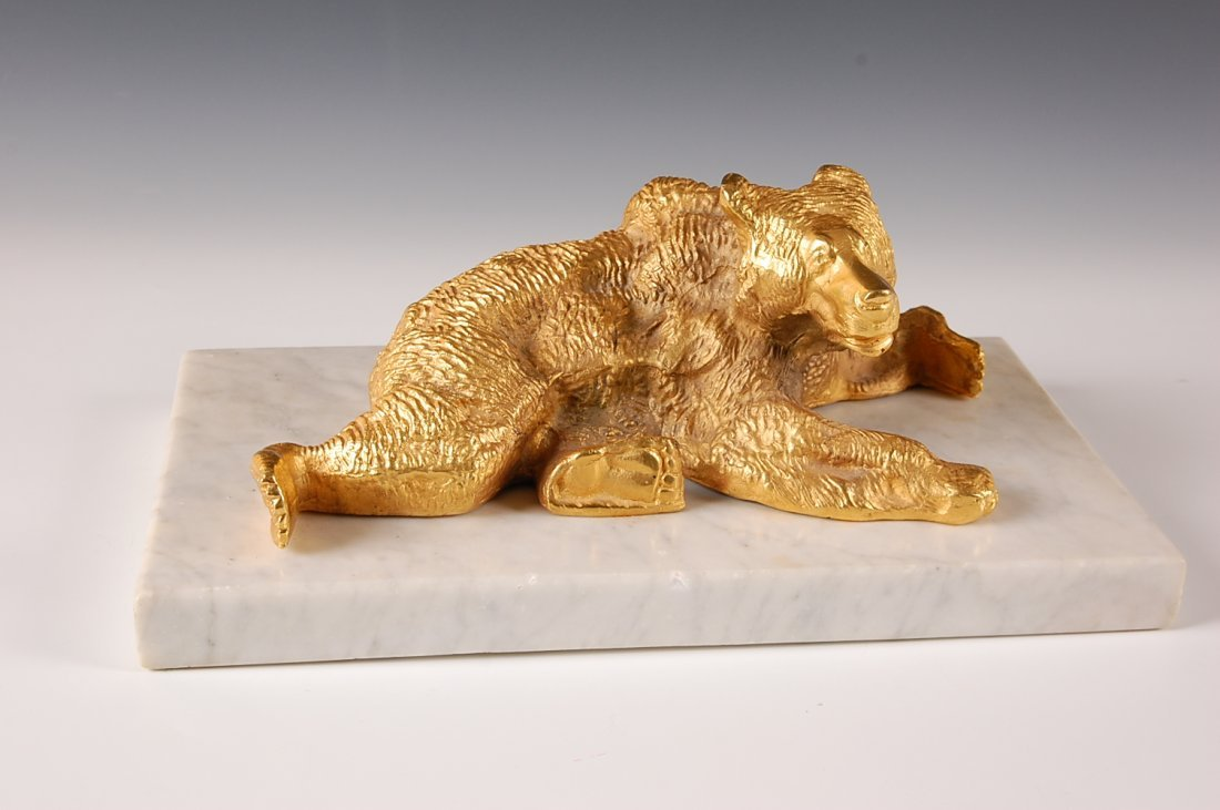 GILDED BRONZE FIGURE OF A BEAR ON MARBLE