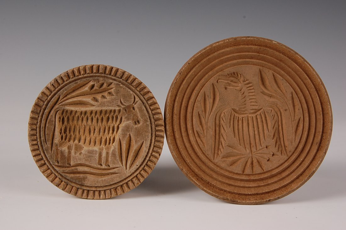 TWO TURNED WOOD BUTTER MOLDS, EAGLE & COW