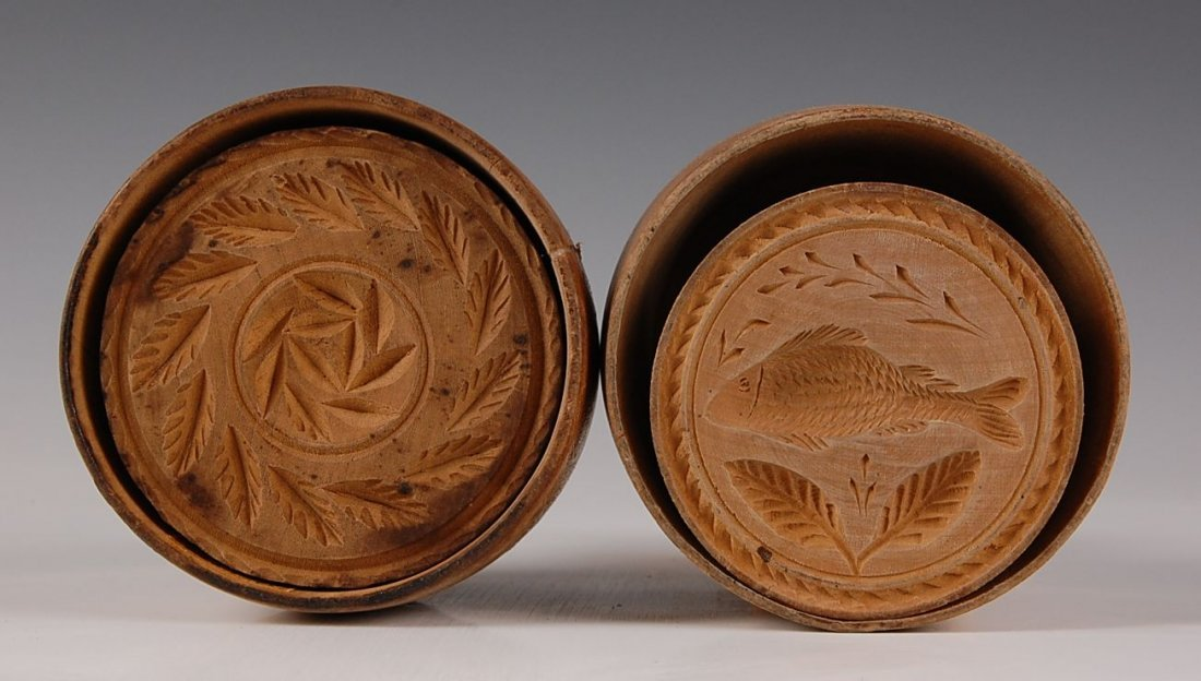 TWO TURNED WOOD BUTTER MOLDS, FISH & WREATH