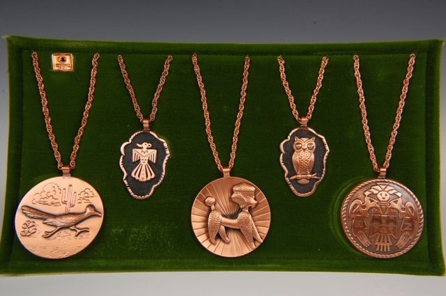FIVE SOLID COPPER MEDALLION PENDANTS BY BELL