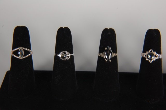 FOUR STERLING RINGS BY BELL TRADING POST, SZ 6.5