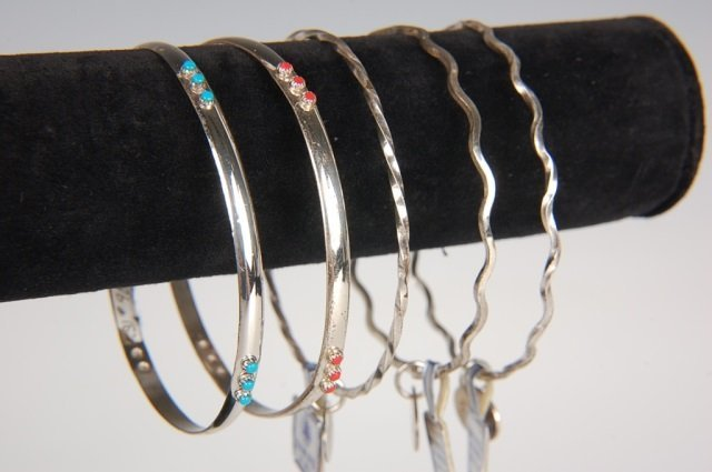 FIVE STERLING SILVER BANGLE BRACELETS BY BELL