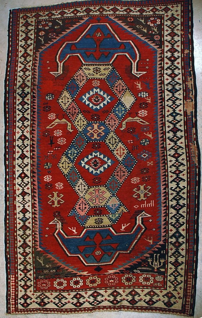 C.1900 CAUCASIAN RUG W/ AVIAN FIGURES AND WOVEN DATE