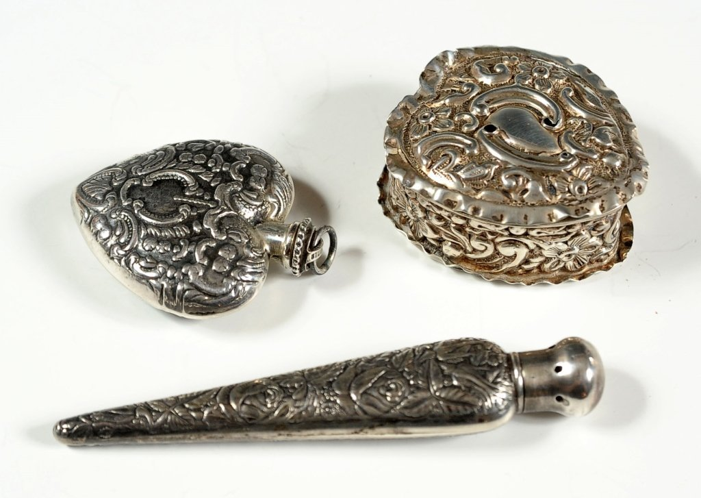 THREE STERLING SILVER ITEMS, PERFUMES AND HEART SHAPED