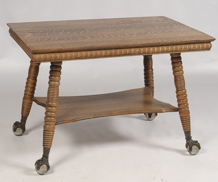 TIGER OAK LIBRARY TABLE WITH LARGE GLASS BALL AND CLAW