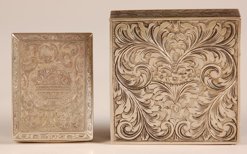 TWO SILVERTONE VANITY CASES WITH CHASED DESIGNS