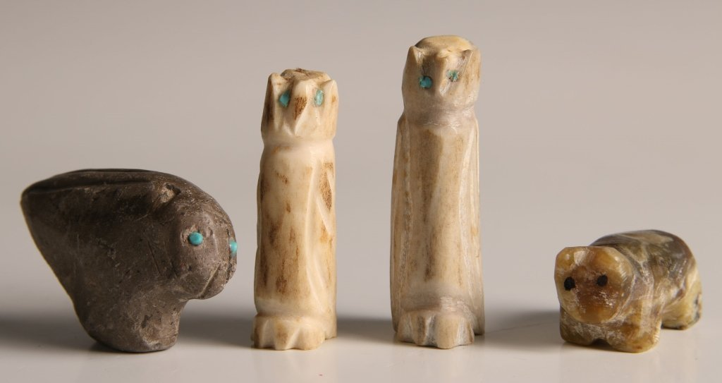 FOUR CARVED BONE AND STONE FETISHES