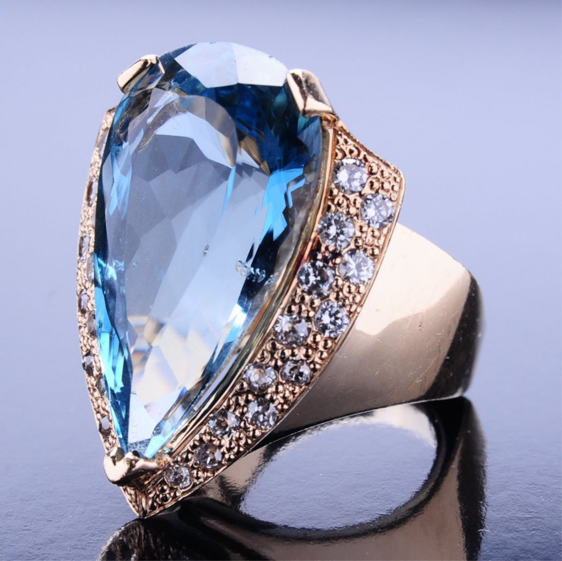LADIES' 32 CARAT BLUE TOPAZ FASHION RING WITH DIAMONDS