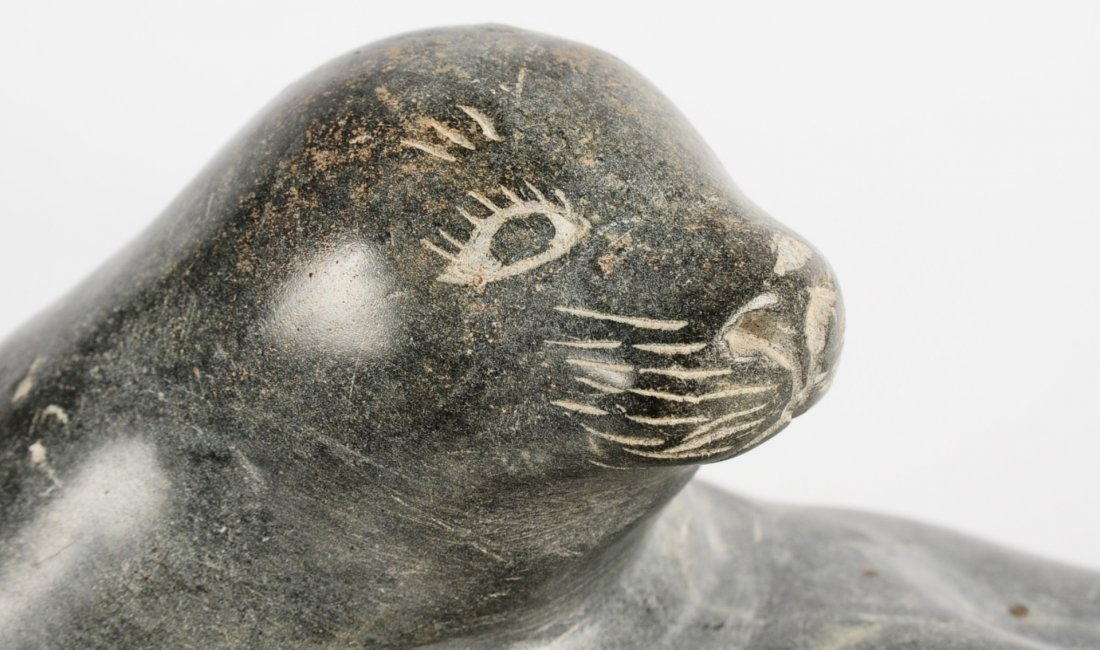 AN INUIT SOAPSTONE SCULPTURE OF SEAL RESTING ON ROCK - 6