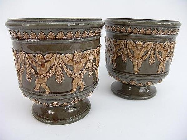 155: PAIR OF DAULTON LAMBETH 1881 FOOTED URNS W/CHERUB