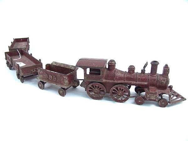 2503: FOUR PIECE CAST IRON TOY TRAIN