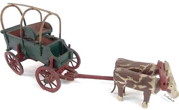 2515: FOLK ART CARVED WOOD OXEN AND WAGON