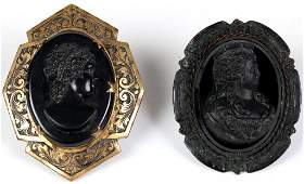 TWO VICTORIAN MOURNING BROOCHES IN METAL MOUNTS