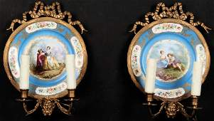 PAIR OF FRENCH PORCELAIN AND BRONZE SCONCES