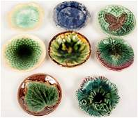 COLLECTION OF EIGHT MAJOLICA BUTTER PATS