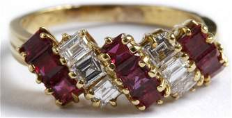 A LADIES 18K GOLD DIAMOND AND RUBY COCKTAIL RING