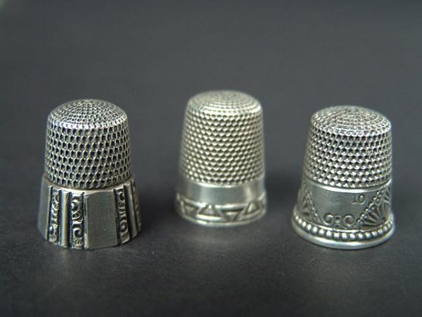 510: THREE STERLING SILVER ANTIQUE THIMBLES