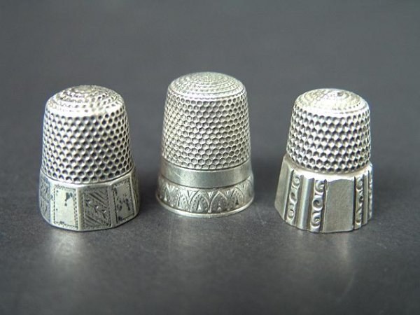 511: THREE STERLING SILVER ANTIQUE THIMBLES