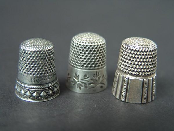 513: THREE STERLING SILVER ANTIQUE THIMBLES