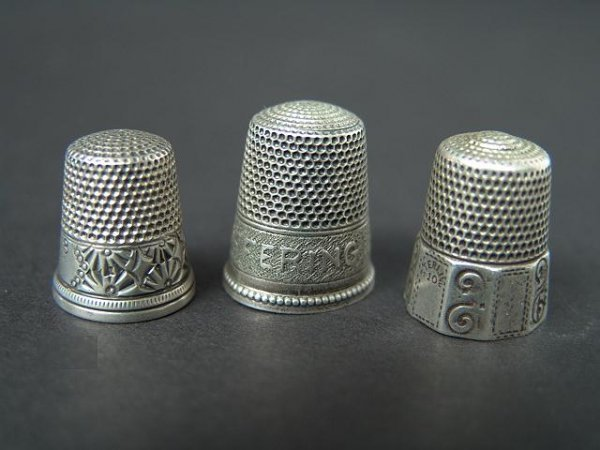 516: THREE STERLING SILVER ANTIQUE THIMBLES