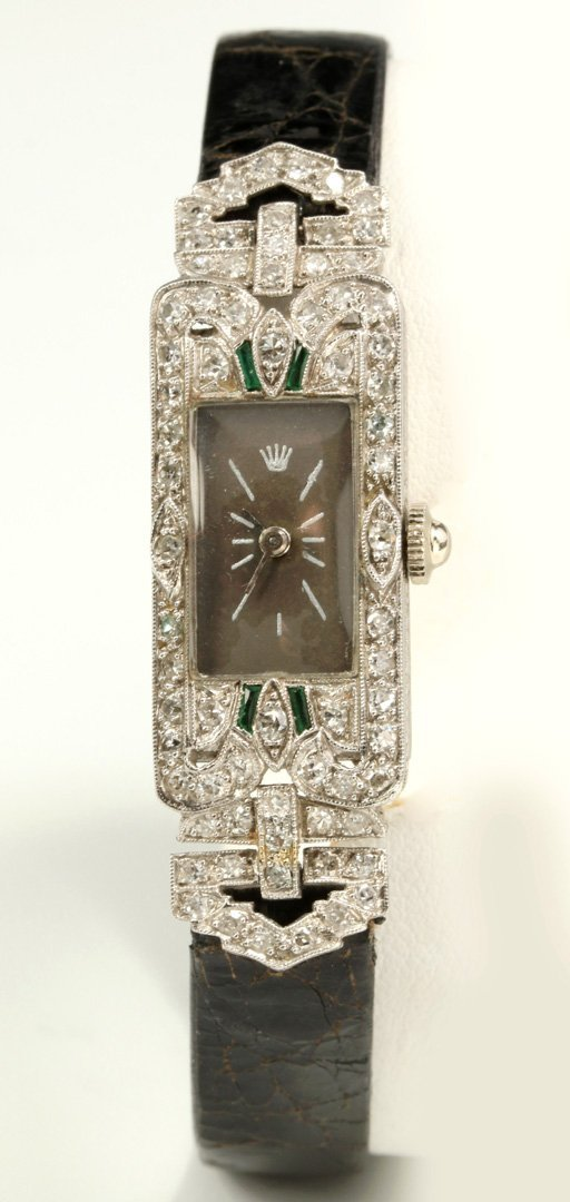 AN ART DECO PLATINUM LADIES' DIAMOND & EMERALD WATCH
