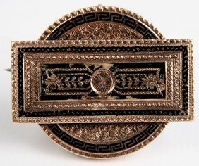 An Antique Victorian Gold Pin With Black Enamel