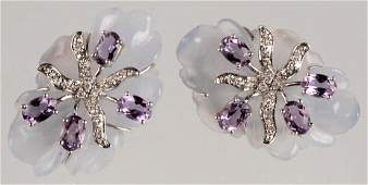 A PAIR OF 14K EARRINGS WITH DIAMONDS AND AMETHYSTS