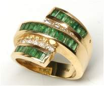 A LADIES 14K GOLD EMERALD AND DIAMOND FASHION RING