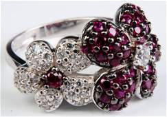 A 14K WHITE GOLD FASHION RING WITH PAVÉ GEMS