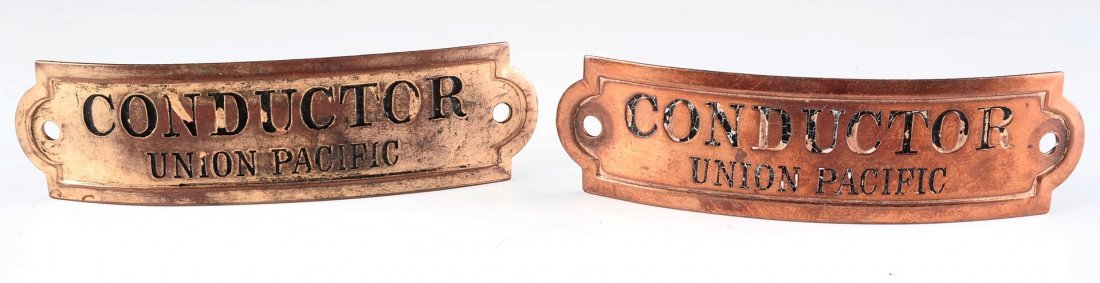 TWO UNION PACIFIC RAILROAD CONDUCTOR CAP BADGES