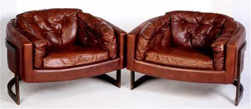 pair metropolitan floating leather barrel chairs