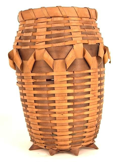 483: N.E. AMERICAN INDIAN FOOTED VASE FORM BASKET IN TW