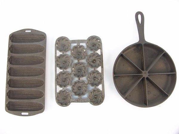 1015: THREE CAST IRON COOKING ITEMS
