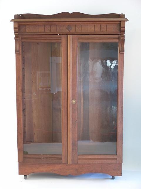 1244: WALNUT TWO DOOR VICTORIAN BOOKCASE TOP